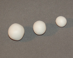 three balls of polymer clay