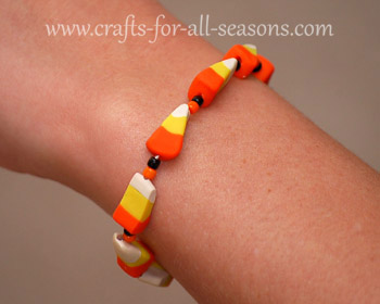 crafty jewelry: candy corn polymer clay cane