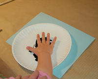 child's hand in paint