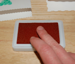 finger on stamp pad