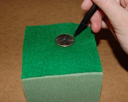 photo of marking quarter on felt