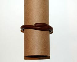 clay around toilet paper roll