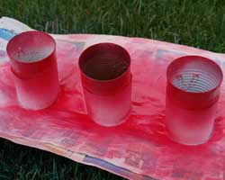 applying red spray paint