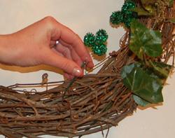adding shamrocks to wreath