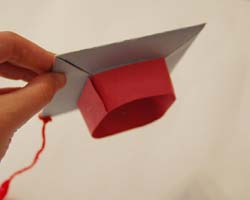 side view of paper graduation cap