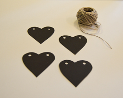 black hearts with holes punched