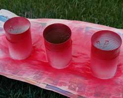 applying red spray paint
