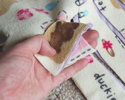 tying fleece knot, step 1
