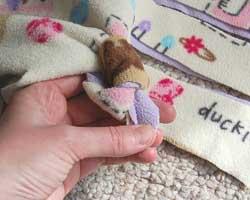tying fleece knot, step 2