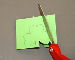 cutting out shamrock