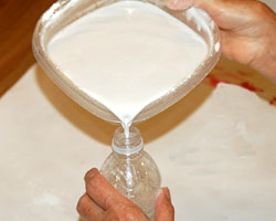 pouring plaster in the bottle