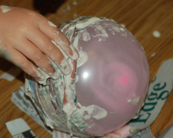 covering balloon with paper mache