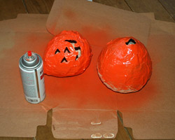 spray painting pumpkins