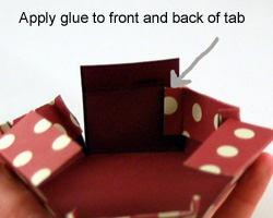 Place the side tab inside the fold on the next side