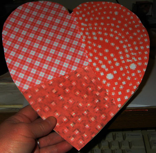 covering heart in paper