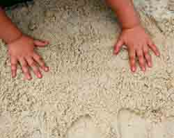 making handprints in the sand