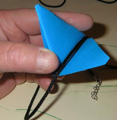 slipping necklace through the triangle