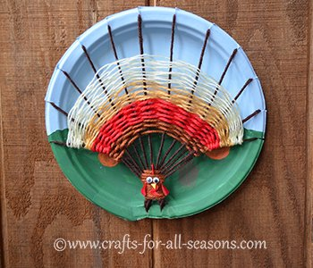 This unique turkey craft for kids is made by weaving yarn on a paper plate to create a beautiful wall hanging for Thanksgiving. Weaving can be done by young ... & Turkey Craft For Kids